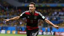 Germany's striker Miroslav Klose celebrating after scoring a goal during the 2014 World Cup semi-finals between Brazil and Germany (MARCOS BRINDICCI/REUTERS)