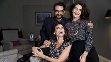 """Actors Amy Landecker, seated, Jay Duplass, left, and Gaby Hoffmann pose for a photo to promote the web series """"Transparent"""" during the Toronto International Film Festival on Sunday, Sept. 11, 2016. (Michelle Siu/AP)"""