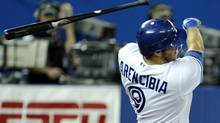 Toronto Blue Jays batter J.P. Arencibia loses his bat while batting against the Texas Rangers during the seventh inning in Toronto April 30, 2012. (MIKE CASSESE/MIKE CASSESE/REUTERS)