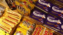 Cadbury's chocolate bars, at right, and Kraft's Toblerone chocolate, lower left, are seen at a store in central London, Tuesday, Jan. 19, 2010. (Sang Tan/Associated Press)