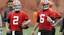 Cleveland Browns quarterback Brian Hoyer (6) gestures to his receivers during a passing drill with Johnny Manziel (2) at a mandatory minicamp practice at the NFL football team's facility in Berea, Ohio Wednesday, June 11, 2014. (Mark Duncan/AP)
