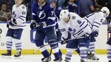 Toronto Maple Leafs right wing Phil Kessel (81), defenseman Jake Gardiner (51), and defenseman Morgan Rielly (44) react after Tampa Bay Lightning defenseman Victor Hedman (77), of Sweden, scored during the third period of an NHL hockey game Tuesday, April 8, 2014, in Tampa, Fla. The Lightning won the game 3-0. (Chris O'Meara/AP)