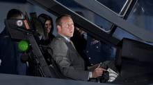 Minister of National Defence Peter MacKay checks out the cockpit of the F-35 Joint Strike Fighter following an announcement in Ottawa on Friday. (Adrian Wyld/THE CANADIAN PRESS/Adrian Wyld)