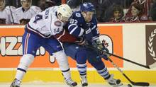 Hamilton Bulldogs' Mike Blunden fights for control of the puck with Toronto Marlies' Leo Komarov during first period AHL action in Hamilton, Ont., on Friday, November 16, 2012. (Kaz Novak/The Canadian Press)