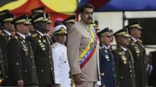 In this June 24, 2017 file photo, Venezuela's President Nicolas Maduro watching a military parade during Army Day celebrations at Fort Tiuna in Caracas, Venezuela. (Fernando Llano/AP)