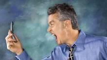 Man yelling at cell phone (Ron Chapple/(C) 2006 Thinkstock)