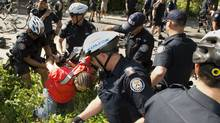 A protester is arrested by police following protest in Toronto on June 21, 2010. The small group of demonstrators marched from Allen Gardens through the downtown core and to the Children's Aid Society building near Yonge and College streets as part of an anti G8/20 protest. (Kevin Van Paassen/Kevin Van Paassen/The Globe and Mail)