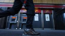 A pedestrian walks past the CIBC ATM machines in Montreal, April 24, 2014. (CHRISTINNE MUSCHI/REUTERS)