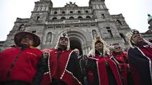 First Nation elders stand on the front steps of the British Columbia Legislature during a protest against the Northern Gateway Pipeline project in Victoria, British Columbia October 22, 2012. (ANDY CLARK/REUTERS)
