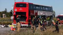 An OC Transpo bus collided with a Via Rail train in the Ottawa suburb of Barrhaven on Sept. 18, 2013. The bus's route number, 76, is being retired by the Ottawa transit authority. (DAVE CHAN FOR THE GLOBE AND MAIL)