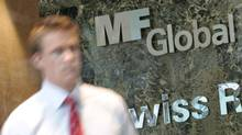A man exits the office complex where MF Global Holdings Ltd have an office on 52nd Street in midtown Manhattan New York, October 31, 2011. (BRENDAN MCDERMID/REUTERS)