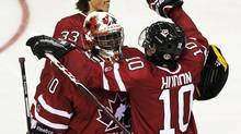 Canada's Charles Hudon, right, celebrates with goaltender Malcom Subban (Andrew Vaughan/The Canadian Press)