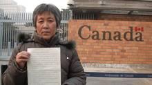 ang Baoying, mother of murdered Chinese student Amanda Zhao outside the gate of the Canadian embassy in Beijing, holding her plea for help, February 18, 2004. (Geoffrey York for The Globe and Mail)