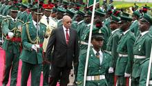 South Africa's President Jacob Zuma reviews a guard of honour at the presidential villa in Abuja, on March 8, 2016, before his meeting with Nigeria's counterpart. South Africa's President Jacob Zuma arrived in Nigeria for a two-day state visit, with ties strained between the continent's two leading nations. (PHILIP OJISUA/AFP/Getty Images)