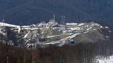 A view from near the alpine course showing the difference between the snow covered piste and the snowless lower slopes at the Sochi 2014 Winter Olympics (Luca Bruno/The Associated Press)