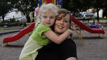 Lisa MacLeod, MPP Nepean-Carleton, plays with her 4-year-old daughter Victoria Varner at a playground on Bay Street on Aug. 10. (Fernando Morales/The Globe and Mail)