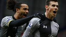 Tottenham Hotspur's Gareth Bale (R) celebrates his goal against West Bromwich Albion with Benoit Assou-Ekotto during their English Premier League soccer match at The Hawthorns in West Bromwich, central England, February 3, 2013. (DARREN STAPLES/REUTERS)