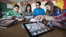 Royan Lee, a teacher at Beverley Acres Public School uses technology to create a more interactive, collaborative and social classroom. Here students learn how to use GarageBand for iPads on November 18, 2011. (Jennifer Roberts for The Globe and Mail)