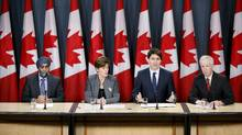 Prime Minister Justin Trudeau speaks during a news conference with Defence Minister Harjit Sajjan (L), International Development Minister Marie-Claude Bibeau (2nd L) and Foreign Minister Stephane Dion in Ottawa, Feb. 8, 2016. (CHRIS WATTIE/REUTERS)