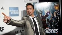 """Robert Downey Jr. poses as he arrives at the screening of the film """"Marvel's The Avengers"""" for the closing night of the 2012 Tribeca Film Festival in New York in this April 28, 2012 file photo. After six consecutive increases, summer ticket sales in the United States and Canada are running 5 percent behind last year's record, according to the box office division of Hollywood.com. (ANDREW KELLY/Reuters)"""