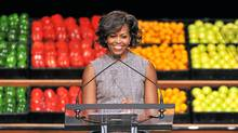 US First Lady Michelle Obama speaks as she joins business leaders from Walmart, an American public multinational corporation that runs a chain of large discount department stores and a chain of warehouse stores, for an announcement impacting food formulation, availability and affordability in Washington, DC, on January 20, 2011. (Mandel Ngan/AFP/Getty Images/Mandel Ngan/AFP/Getty Images)