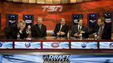 Team executives chat moments before the NHL Draft Lottery at the TSN studios in Toronto on Tuesday April 10, 2012. (Aaron Vincent Elkaim/THE CANADIAN PRESS)