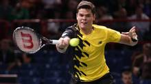 Milos Raonic of Canada hits a return to Robin Haase of the Netherlands at the Paris Masters men's singles tennis tournament at the Palais Omnisports of Bercy in Paris, October 30, 2013. (CHARLES PLATIAU/REUTERS)