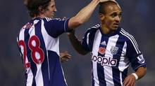 West Bromwich Albion's Peter Odemwingie (R) celebrates his goal against Southampton with Billy Jones during their English Premier League soccer match at The Hawthorns in West Bromwich, central England, November 5, 2012. (DARREN STAPLES/REUTERS)