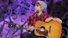 Justin Bieber performs songs from his hit album Under the Mistletoe at Massey Hall in Toronto, Dec. 21. MuchMusic/George Pimentel for WireImage (George Pimentel/MuchMusic)