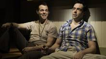Stuart Hughes and Mike Ross in True West at Soulpepper Theatre Company. (Cylla von Tiedemann)