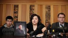 Maureen Luggi, joined by her son Robert Jr., talks about her husband, Robert, at the B.C. Legislature on March 6, 2014. (CHAD HIPOLITO FOR THE GLOBE AND MAIL)