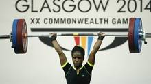 Chika Amalaha of Nigeria, makes good lift during the  women's 53 kg weightlifting competition at the Commonwealth Games Glasgow 2014, in Glasgow, Scotland, Friday, July, 25, 2014 (Associated Press)