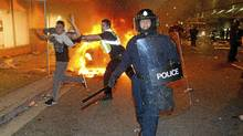 Police try to move rioters in the streets of Vancouver on Wednesday, June 15, 2011. (JOHN LEHMANN/JOHN LEHMANN/THE GLOBE AND MAIL)