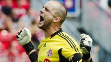 Toronto FC goalkeeper Stefan Frei celebrates after his team defeated the Vancouver Whitecaps to win the Canadian Championship final soccer match in Toronto, July, 2, 2011. REUTERS/Mark Blinch (Mark Blinch/Reuters)