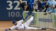 Toronto Blue Jays Jose Bautista misses a diving catch against the Baltimore Orioles in foul territory during the ninth inning. (MARK BLINCH/Reuters)