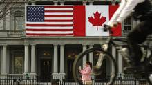 U.S. and Canadian flags are placed side-by-side on the Eisenhower Executive Office Building next to the White House in this file photo. (KEVIN LAMARQUE/REUTERS)