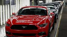 The first 2015 Ford Mustang moves along the production line at the company's Flat Rock Assembly Plant in Flat Rock, Michigan, U.S., on Thursday, Aug 28, 2014. Ford Motor Co. begins building the sixth generation of its 50-year-old Mustang sports car today at a Michigan plant that will export it to more than 120 countries. (Jeff Kowalsky/Bloomberg)