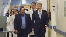 Prime Minister Stephen Harper, right, chats with Dr. Arthur Porter, left, at the Montreal General hospital in Montreal Friday Nov.24, 2006. (Ryan Remiorz/CP)