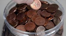 Finance Minister Jim Flaherty announced the surprise demise of the one-cent coin in last year's budget, saying the penny had become a nuisance. (Ryan Remiorz/THE CANADIAN PRESS)