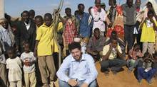 Canadian author Jay Bahadur poses with Somali villagers in Dhanane, the semiautonomous region of Puntland, Somalia, on June 1, 2009, while researching his book about piracy. (Stringer/AP)