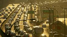 Traffic piles up on the Gardiner Expressway as commuters head home during the evening rush hour in Toronto, Ont. March 14/2011. (Kevin Van Paassen/The Globe and Mail/Kevin Van Paassen/The Globe and Mail)