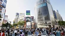 A Tokyo subway pass will help navigate the masses. (Shizuo Kambayashi)