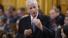"""Mr. Dion refused to apologize after Conservative MP Ed Fast called the gesture """"offensive."""" (Adrian Wyld/THE CANADIAN PRESS)"""