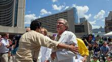 Doctor Philip Berger, chief of family and community medicine at St. Michael's hospital was one of several doctors who protesed the recent decision to cut health care for refugees at the Pan/Parapan Am Day celebration in Toronto at Nathan Phillips Square, July 10, 2012. (Galit Rodan/The Globe and Mail)