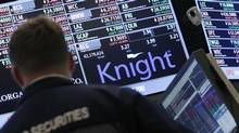 A trader stands by the post that trades Knight Capital on the floor of the New York Stock Exchange on August 2. (BRENDAN MCDERMID/REUTERS)