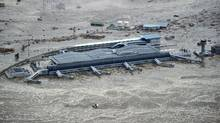 Sendai Airport is surrounded by waters in Miyagi prefecture (state), Japan, after a ferocious tsunami spawned by one of the largest earthquakes ever recorded slammed Japan's eastern coast Friday, March 11, 2011. (AP Photo/Kyodo News) (AP)