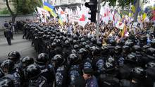 Thousands marched through central Kiev to protest pension reforms agreed to by the Ukrainian government as part of a loan deal with the International Monetary Fund. (Sergei Chuzavkov/Associated Press/Sergei Chuzavkov/Associated Press)