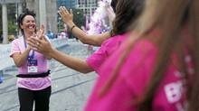 walker is congratulated at the finish line of the Weekend to End Women's Cancers (Della Rollins for The Globe and Mail)