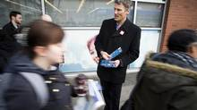 Mayor Gregor Robertson speaks to commuters about the transit referendum while they wait for a bus at the Broadway-Commercial SkyTrain Vancouver, March 6, 2015. (Ben Nelms for The Globe and Mail)