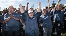 Auto assembly workers cheer during a press conference to announce the future production of the Ford Motor Fusion vehicle at the newly named Flat Rock Assembly Plant in Flat Rock, Michigan on September 10, 2012. (REBECCA COOK/REUTERS)